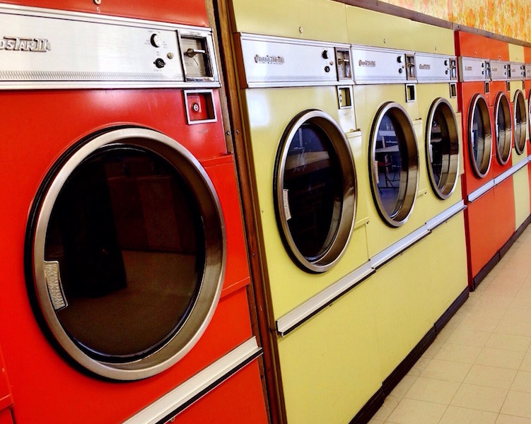 Laundry is a chore that many people dislike, and it's a chore that most people want to leave behind while they travel. However, doing laundry on the road can free up space in your luggage for other valuable items or souvenirs. Thankfully, there are several ways to do laundry while you travel for a variety of preferences, making the chore less of a hassle.   Full Laundry Service 	If you're willing to pay the price, using a full laundry service is a convenient option. Many hotels offer these services, making it an easy and stress-free task. However, fees can get pretty pricy, so it's important to do some research on the services and prices beforehand to know what to expect.   Laundromats 	This is a less expensive option that still allows you to use the convenience of a machine. Laundromats are common services around the world and can typically be found without a problem. The staff at your hotel or hostel will be able to point you in the right direction of the nearest laundromat. Additionally, you can do some research before your trip to find information on local laundry services.    Laundry Kits and Gadgets  	There are several laundry supplies out there that you can purchase to bring with you on your travels. A travel laundry kit is a nice option to ensure you have what you need to wash your clothes. These kits typically include detergent, a sink stopper, a drying line, and a storage bag. Another helpful product is the Scrubba portable laundry bag. This gadget is a bag made with knots on the inside to help scrub your clothes clean.   Free Laundry Options 	Washing your clothes in the sink is a popular way to do laundry on the road, as it's free and can be done in the convenience of your hotel or hostel. This process simply requires you to fill the sink with warm water, soak your clothes, add soap, hand wash each item, rinse, and dry. Another free option is to fill a Ziploc bag with warm water, a bit of detergent, and your clothes, mixing them around and letting them soak before rinsing and drying. Your clothes can be dried using a travel drying line or anything else you can find to hang them on. It is helpful to have them as dry as possible before hanging them. One effective way to do this is to roll your wet clothes up in a towel and apply pressure to the towel to soak up the moisture.   Final Laundry Tips 	To prepare for your trip, pack clothes that can be worn several times before washing. Denim is one material that can be worn over and over again without needing to be washed. In addition, avoid packing materials that wrinkle easily, such as cotton. If you pack smart, you can limit the amount of laundry you will have to do and make it easier on yourself.   	With these options for doing laundry on the road, you can save yourself luggage room and unnecessary frustration.